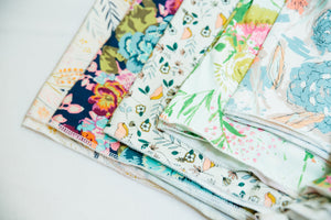pile-of-handmade-floral-baby-blankets