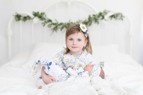 newborn-baby-photos-blue-floral-dress-green-garland-pinterest-ideas-big-sister-little-sister-matching-dresses-etsy