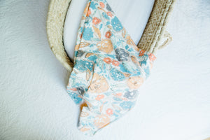 coral and blue floral swaddle blanket