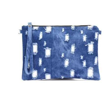 Distressed denim Clutch