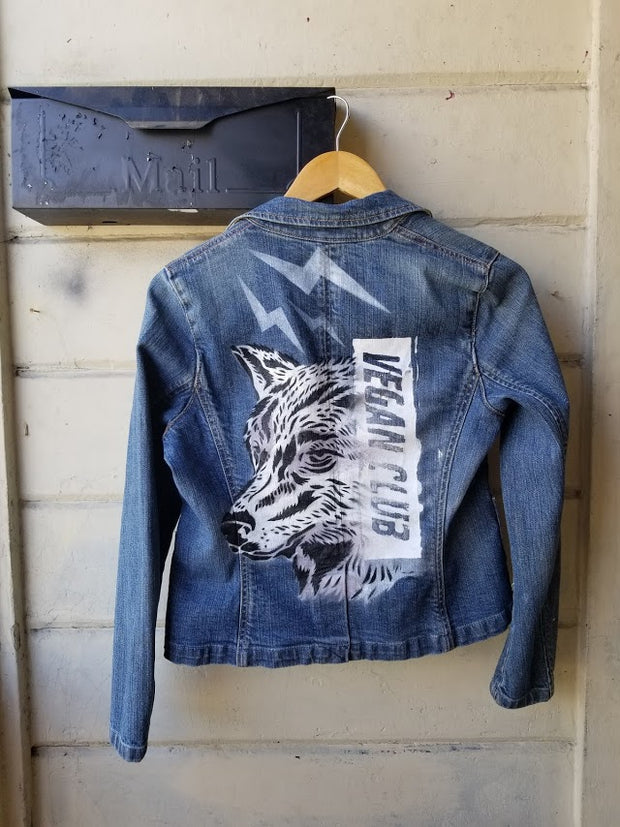 One of a Kind Upcycled Jean Jacket Vegan Club featuring a wolf (anti-fur message) hand painted by @praxis_vgz