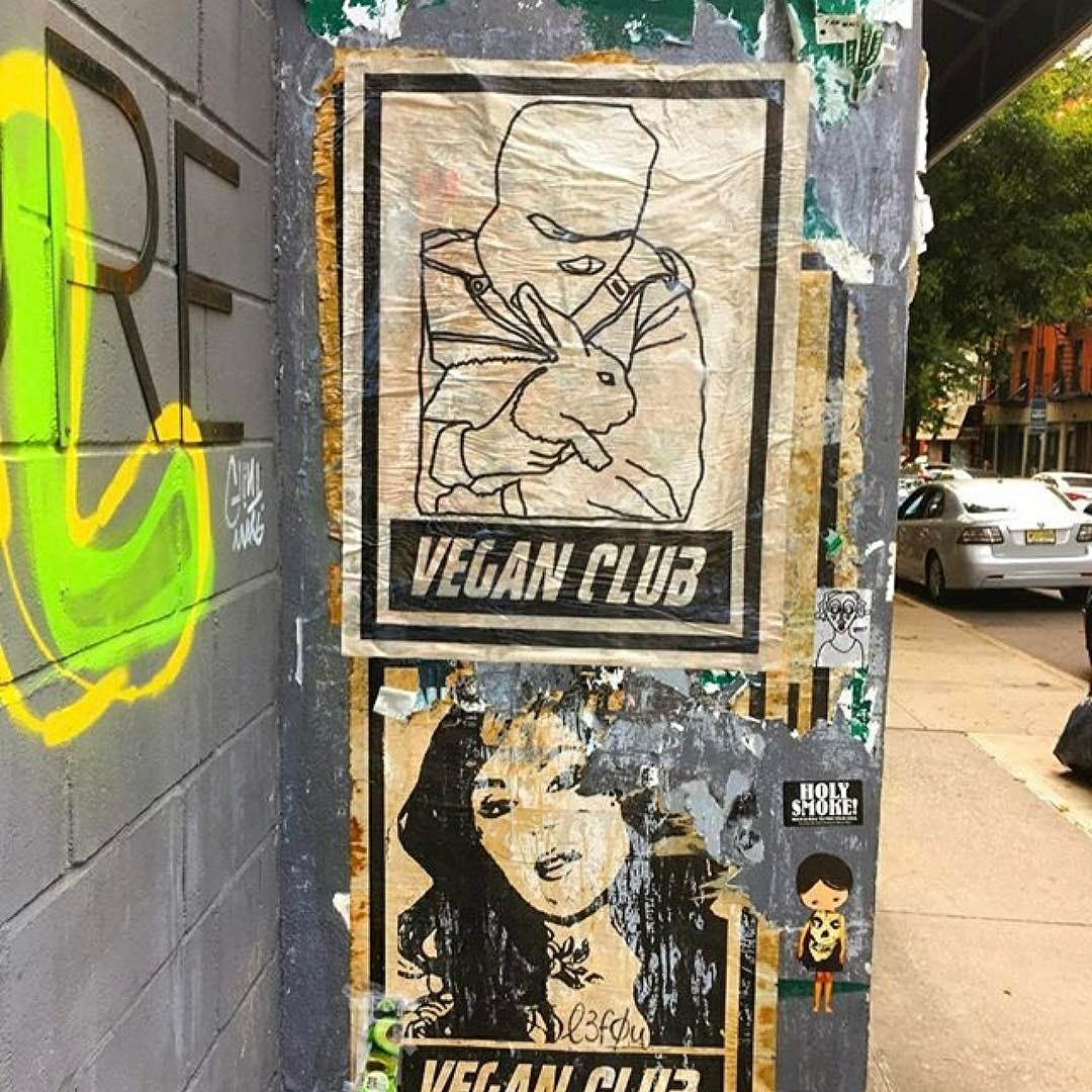 Street Art NewsPrint Poster Vegan Club featuring ALF Animal Liberation Front Saving a Rabbit from Experiment by Le Fou
