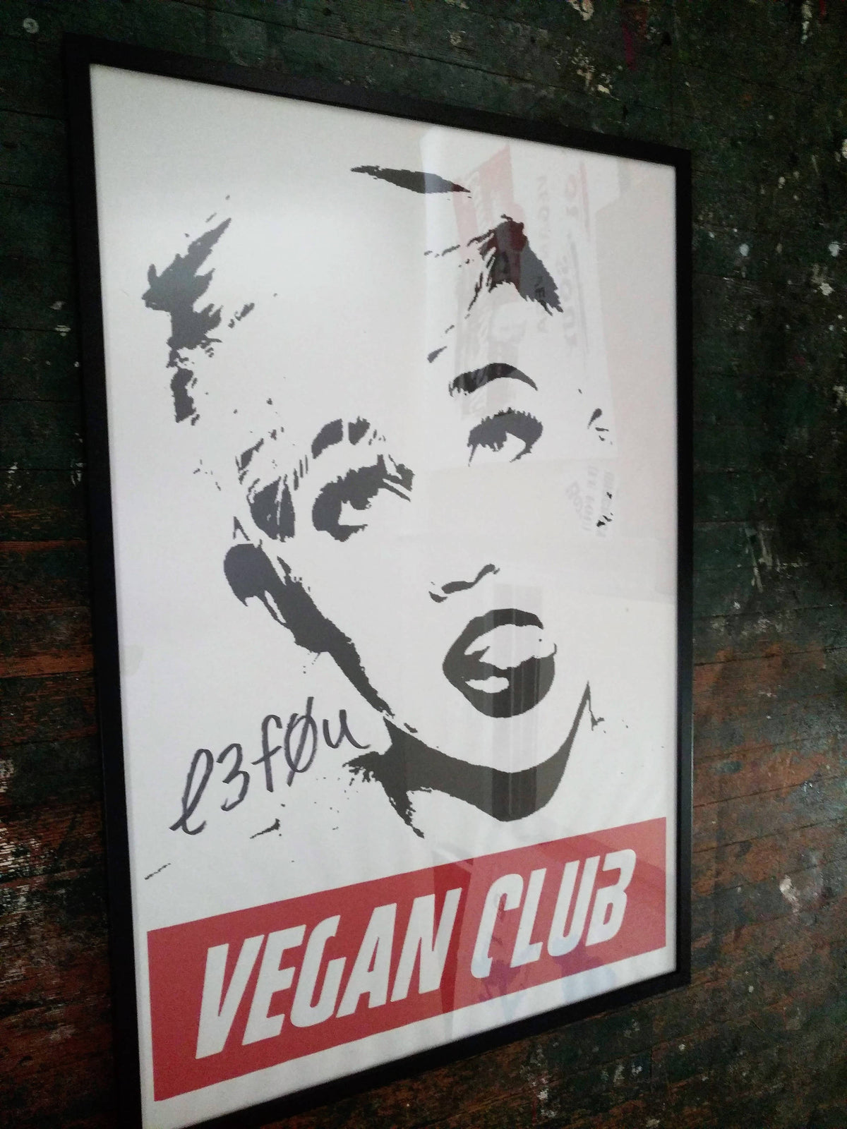 Framed on black wood Street Art NewsPrint Poster 24x36 Vegan Club featuring Miley Cyrus signed by LeFou - pic @street_art_los_angeles