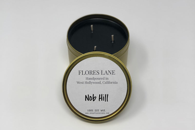 3 wick Nob Hill is one of those scents that captivates you because of its complexity. The base notes re vetiver and white patchouli which gives it an earthy but almost musky tone topped off with spicy yet smooth notes of sandalwood + ylang ylang. The candle itself is black (wax) on black (recycled glass jar)  It's made of all natural soy wax and a natural charcoal-based black dye, the candle is scented with essential oils.