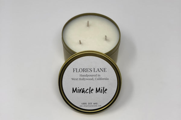 3 wick Miracle Mile is a sexy blend of musk flower and top notes of sandalwood. The candle itself is black (wax) on black (recycled glass jar)  It's made of all natural soy wax and a natural charcoal-based black dye, the candle is scented with essential oils.