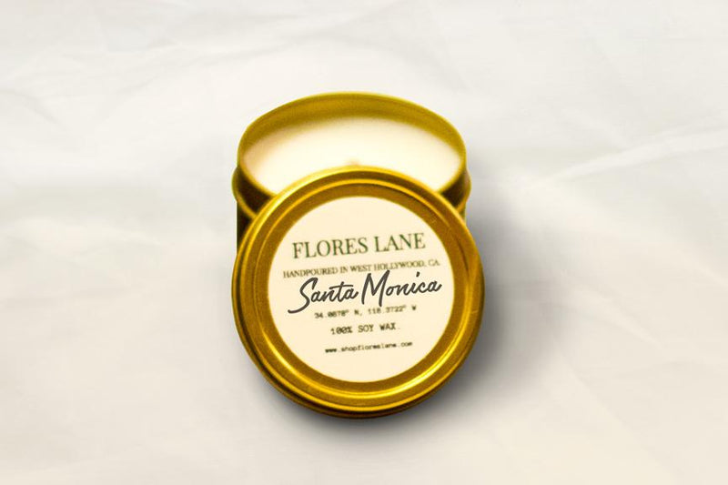travel size  Santa Monica is located by the ocean but also has a ton of amazing restaurants, shops, and historical locations to check out. The blend includes warm base notes of sandalwood and vanilla with hints of lemon. The candle is made of all natural soy wax inside of a white recycled glass and is scented with essential oils.