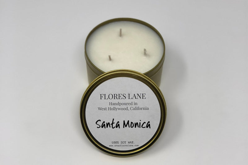 3 wick size  Santa Monica is located by the ocean but also has a ton of amazing restaurants, shops, and historical locations to check out. The blend includes warm base notes of sandalwood and vanilla with hints of lemon. The candle is made of all natural soy wax inside of a white recycled glass and is scented with essential oils.