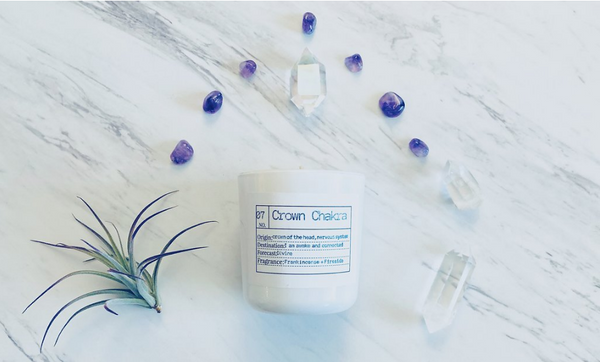 The Crown Chakra candle is a warm, rich blend of frankincense and smokey fireside.