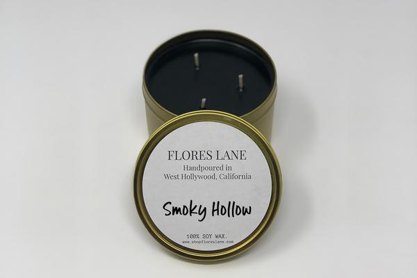 Smoky Hollow is a magical blend of black amber, vanilla, and oak. The candle itself is black (wax) on black (recycled glass jar). It's made of all natural soy wax and a natural charcoal-based black dye, the candle is scented with essential oils.