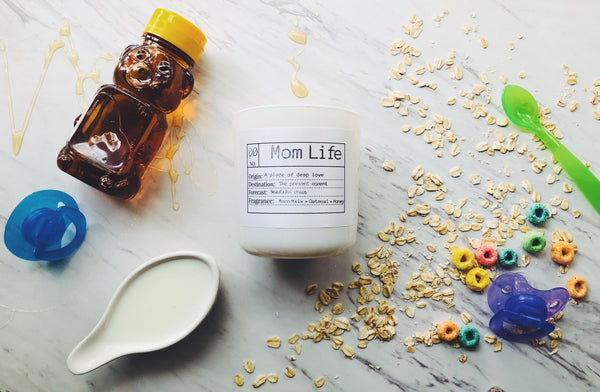 Mom life is a soothing blend of moon milk (which smells like a sexy milk man) + oatmeal + and top notes of sweet honey.  It's subtle yet warming like a fuzzy blanket for your nose. It's the perfect candle for all the mom's in your life ( plant mom's included)!
