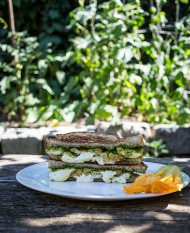Grilled cheese with pesto and fried squash blossoms, assembled