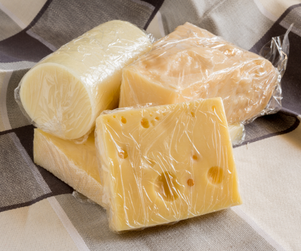 should you wrap cheese in plastic wrap?