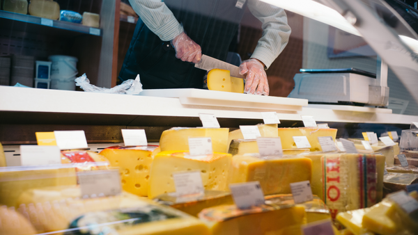 buying cheese at a cheese counter
