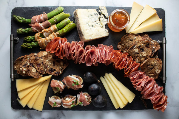 full cheese board on slate with pairings