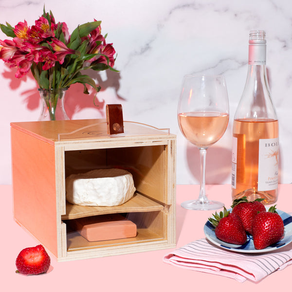 rose wine and cheese pairing with strawberries in a Cheese Grotto