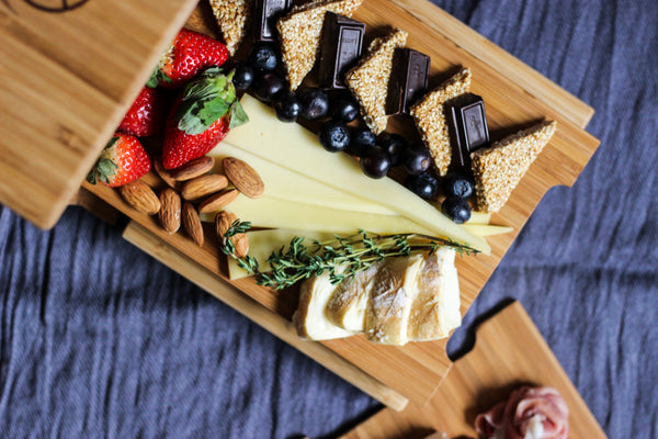 cheeseboard on a bamboo serving tray