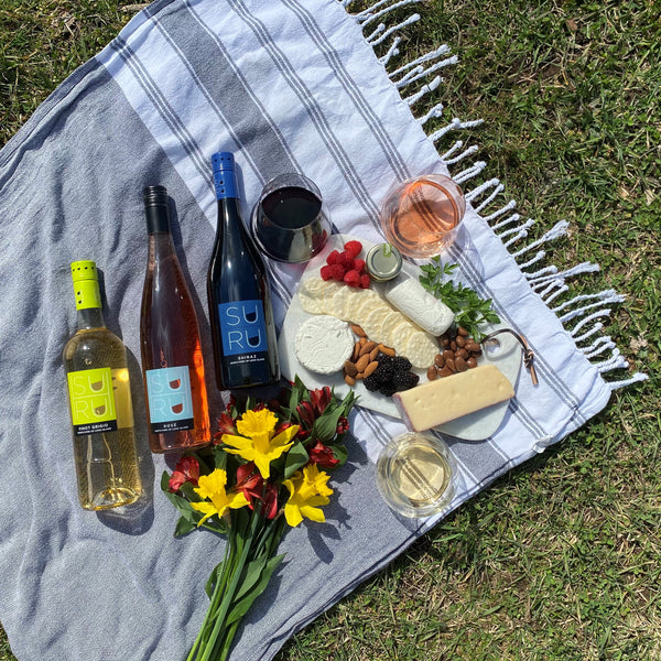 spring wines and cheeses for a picnic