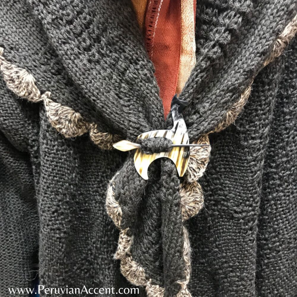 Handmade luxury sweater pins made from bull horns.