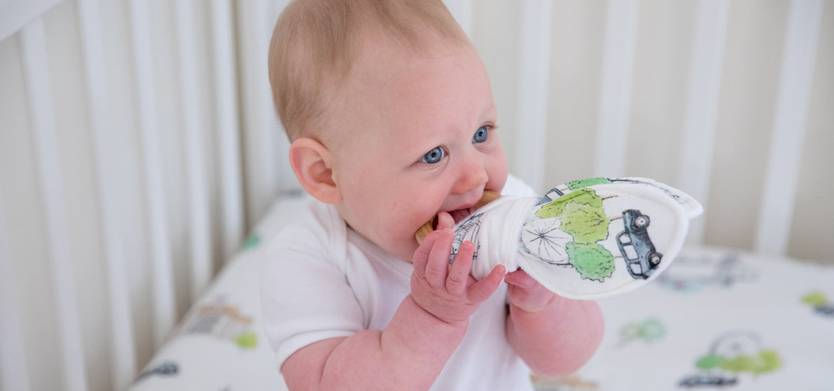 baby with natural wooden baby teething ring in London design