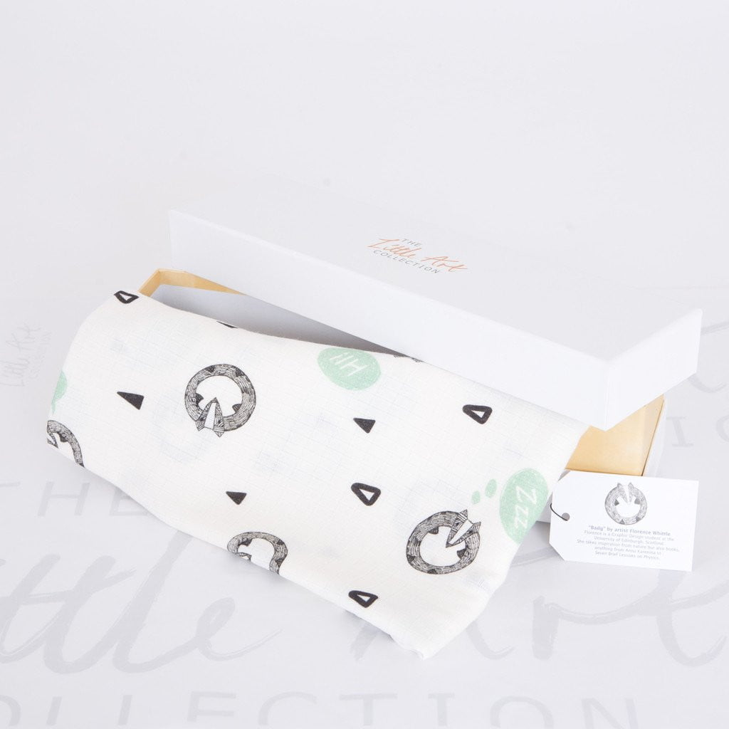 image of badger swaddle blanket with gift box