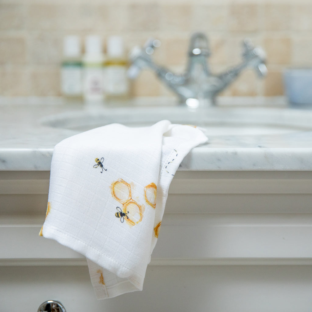 Image of bamboo muslin face cloth hanging over sink