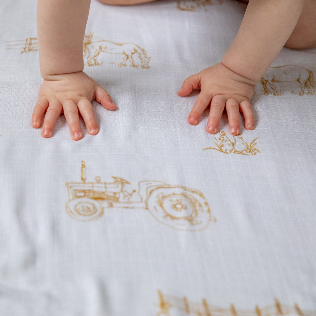 Image of baby hands on Farm muslin square