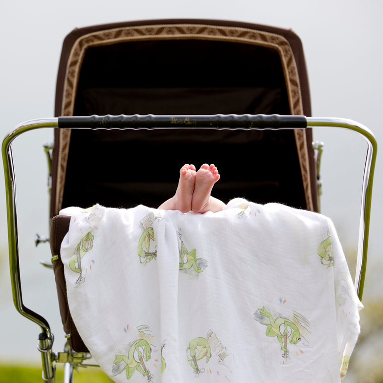 Baby feet on pram with bamboo swaddle blankets