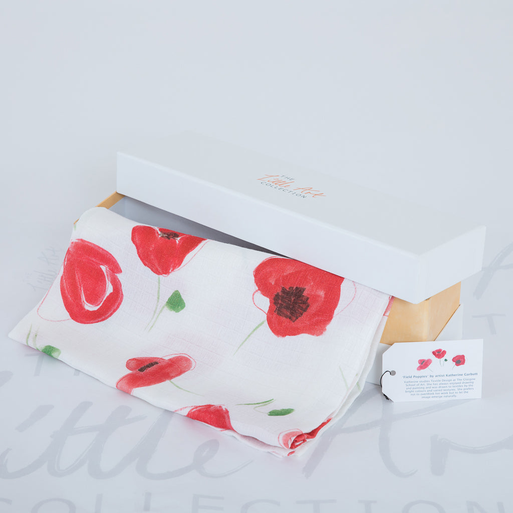 image of poppy swaddle blanket with gift box