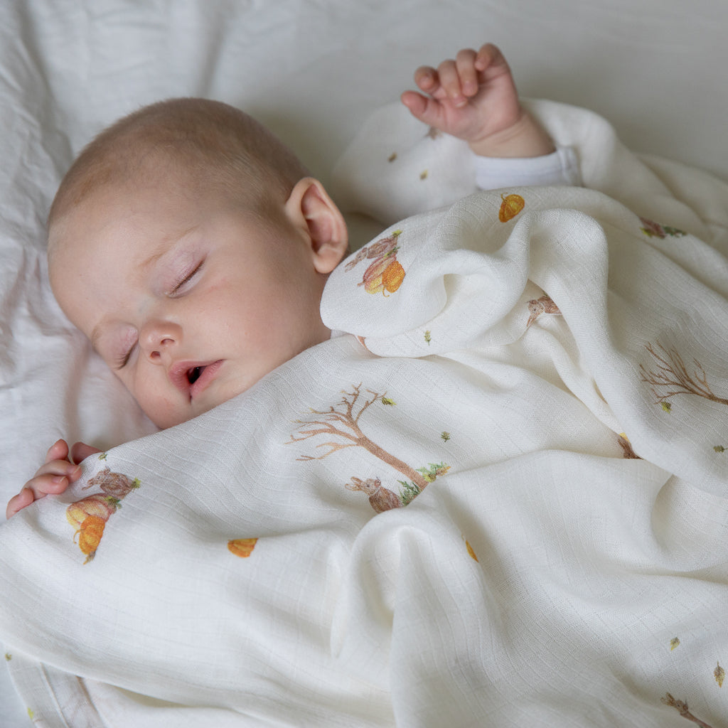 Baby sleeping in bamboo swaddle blankets