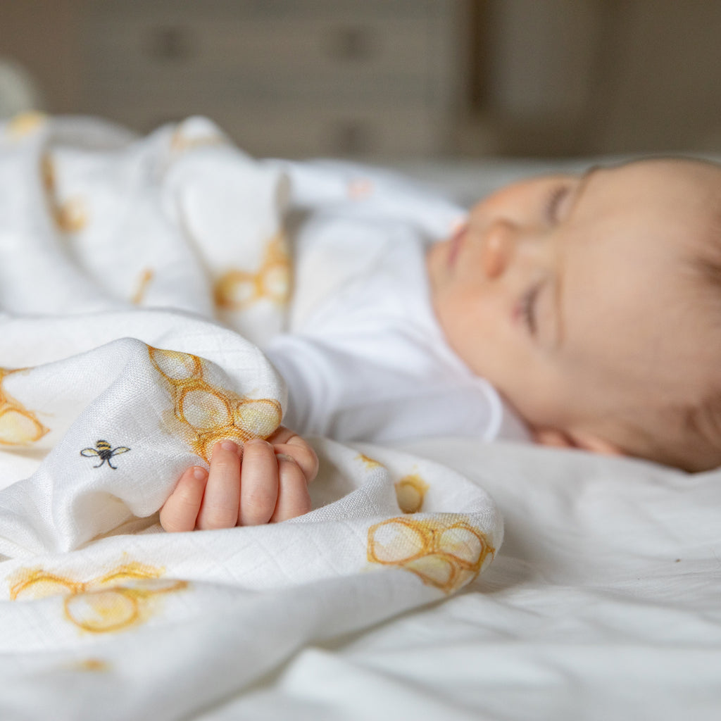 Image of baby sleeping with swaddle blanket