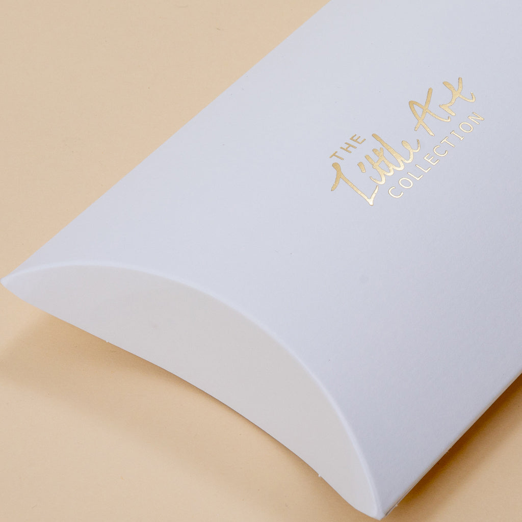 Image of little white pillow box
