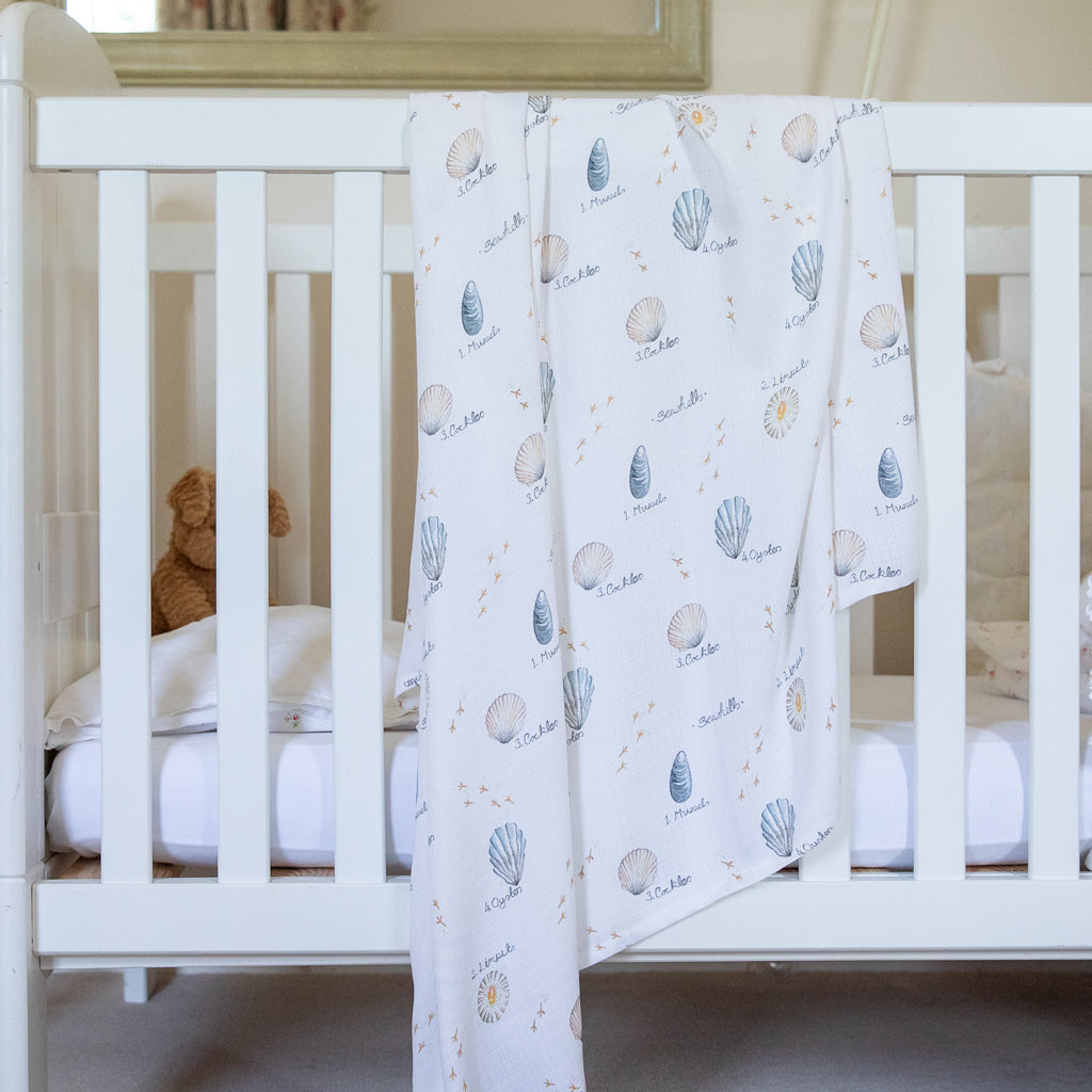 Image of swaddle blanket hung over cot