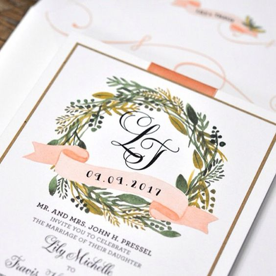 wedding invitation with wreath and monogram