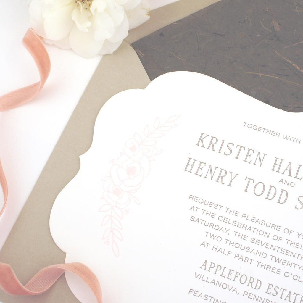 Die cut wedding invitation with floral design and handmade paper envelope liner