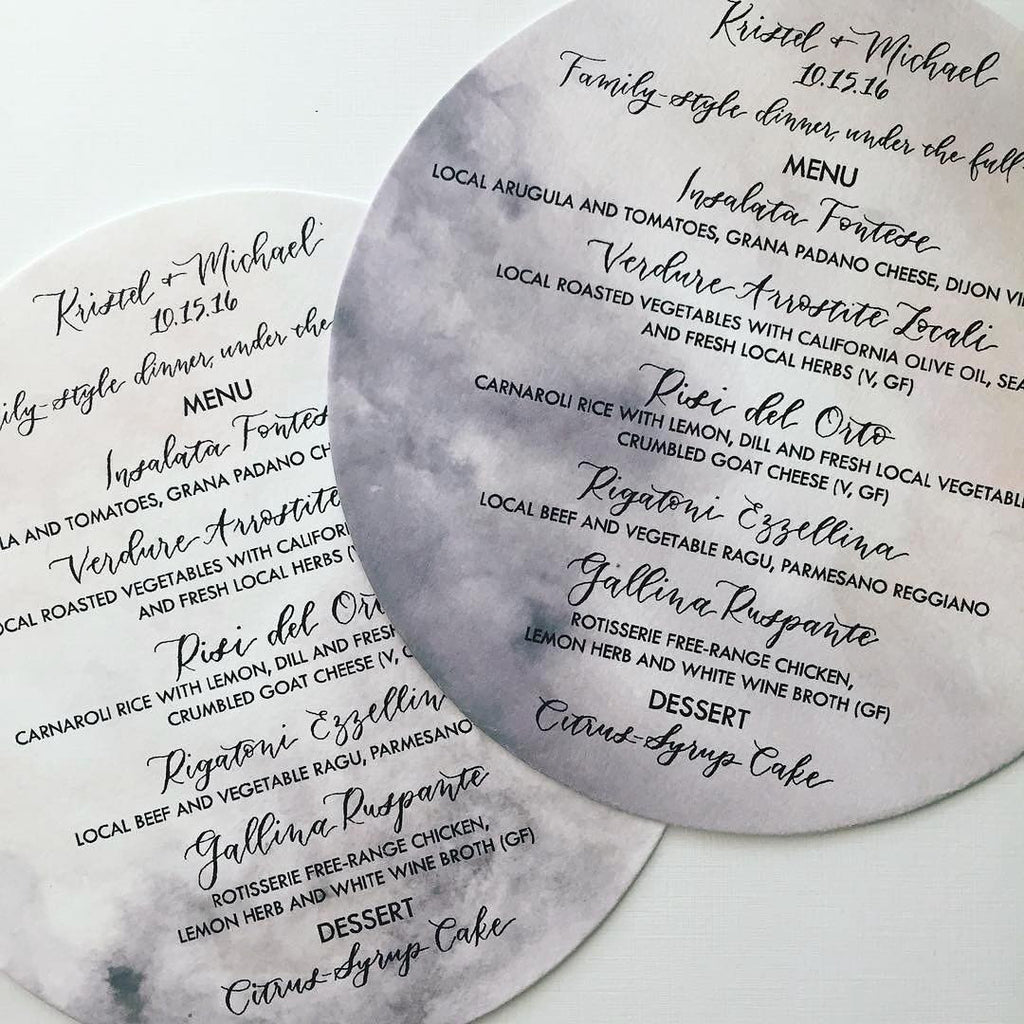 circle die cut wedding menu with gray watercolor and black calligraphy