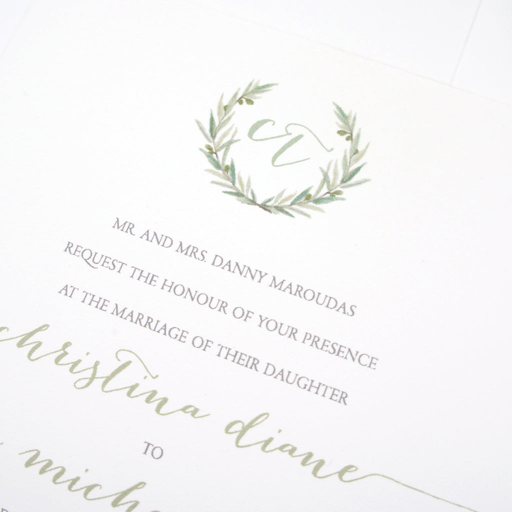 watercolor leaves into wreath with monogram for wedding invitation