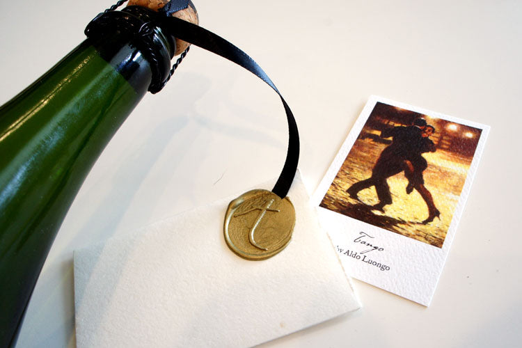 gold wax seal on wine bottles for celebration