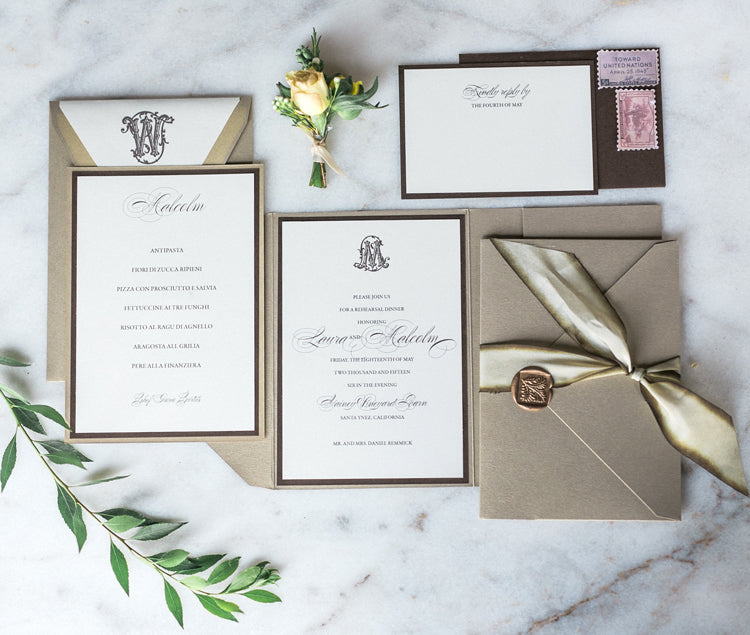 elegant neutral wedding suite with gold wax seal