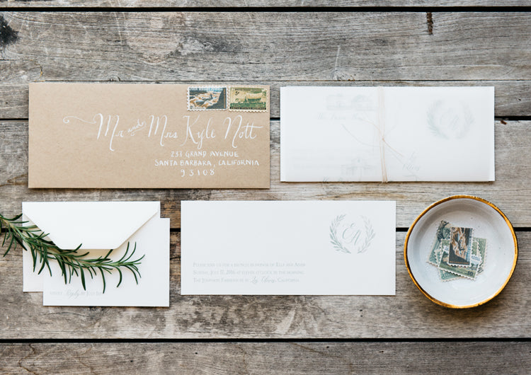 greenery and custom monogram for wedding invitation