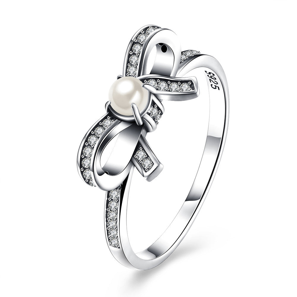 Sterling Silver Pandora Inspired Pearl Bow Ring - Golden NYC Jewelry www.goldennycjewelry.com fashion jewelry for women