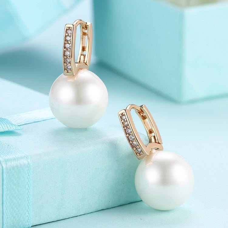 Micro-Pav'e Austrian Crystal Curved Pearl Huggie Earrings Set in 18K Gold - Golden NYC Jewelry