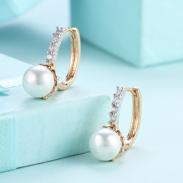 Swarovski Crystal Curved Pav'e Pearl Huggie Earrings Set in 18K Gold - Golden NYC Jewelry www.goldennycjewelry.com fashion jewelry for women