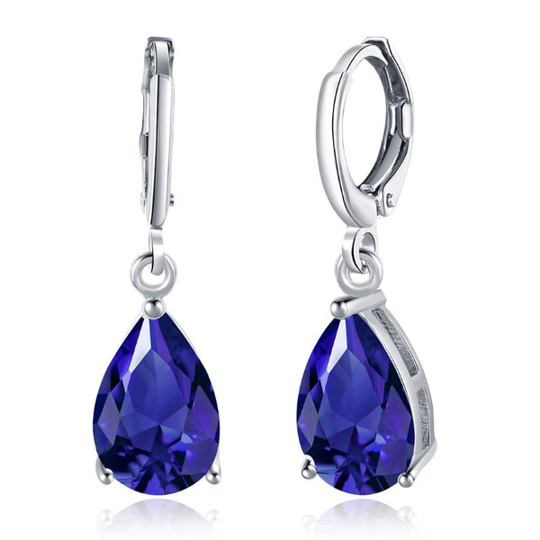 Simulated Sapphire Pear Shaped Drop Earrings Set in 18K White Gold - Golden NYC Jewelry Pandora Jewelry goldennycjewelry.com wholesale jewelry