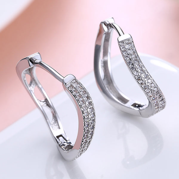 Swarovski Crystal Infinity Design Hoop Earrings Set in 18K White Gold - Golden NYC Jewelry www.goldennycjewelry.com fashion jewelry for women