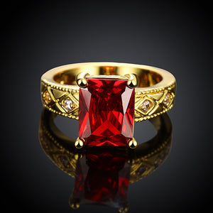 Ruby Emerald Cut Center Halo Ring in 14K Gold
