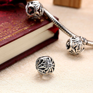 Sterling Silver Laser Cut Floral Design Charm - Golden NYC Jewelry www.goldennycjewelry.com fashion jewelry for women