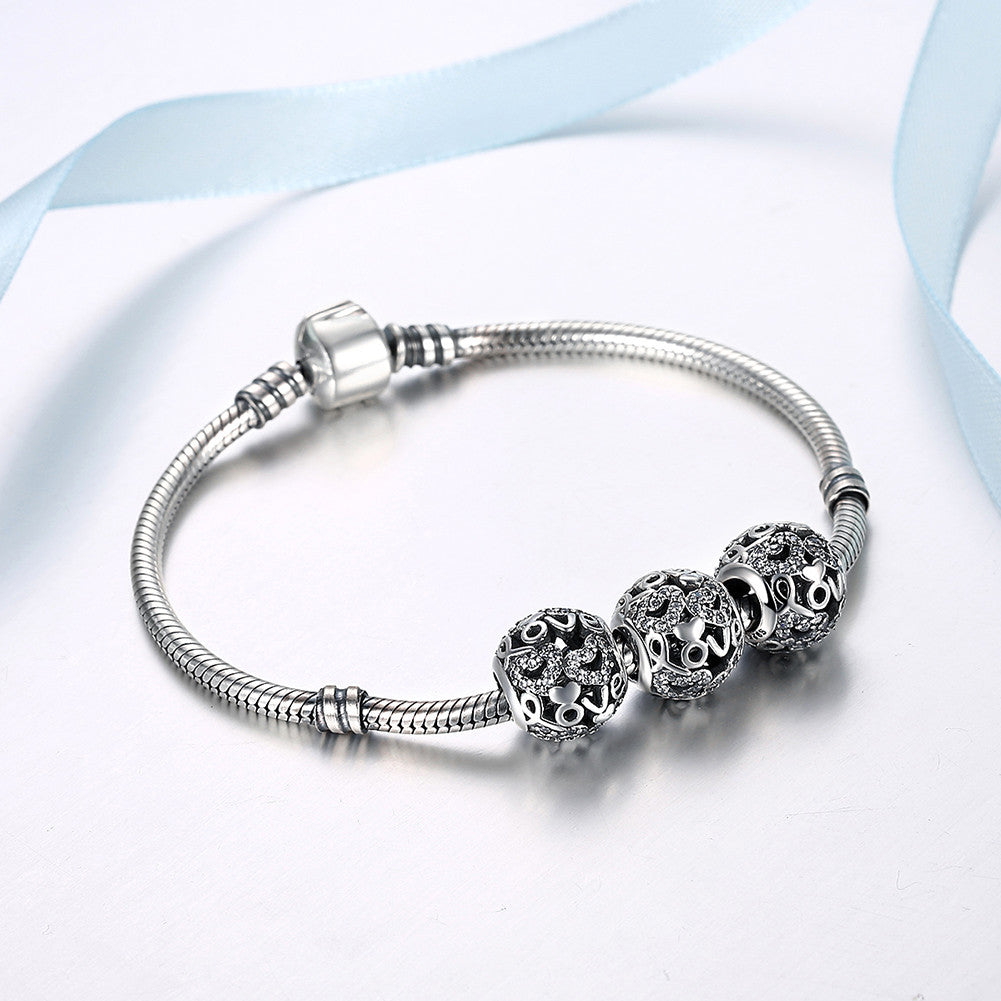 Sterling Silver Love CZ Charm - Golden NYC Jewelry www.goldennycjewelry.com fashion jewelry for women