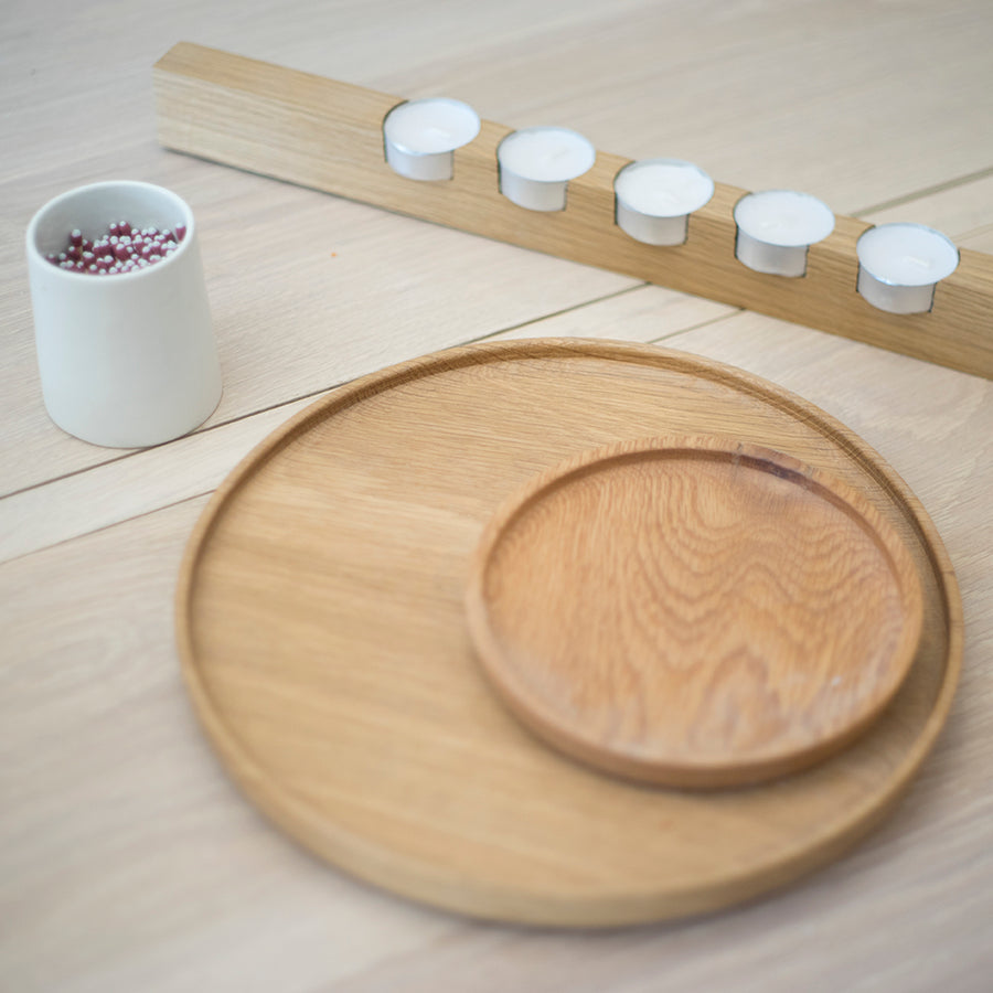 White oak wood plate in medium and extra large with a white oak Offset Multi 5 tealight holder and a white porcelain Arenal match striker