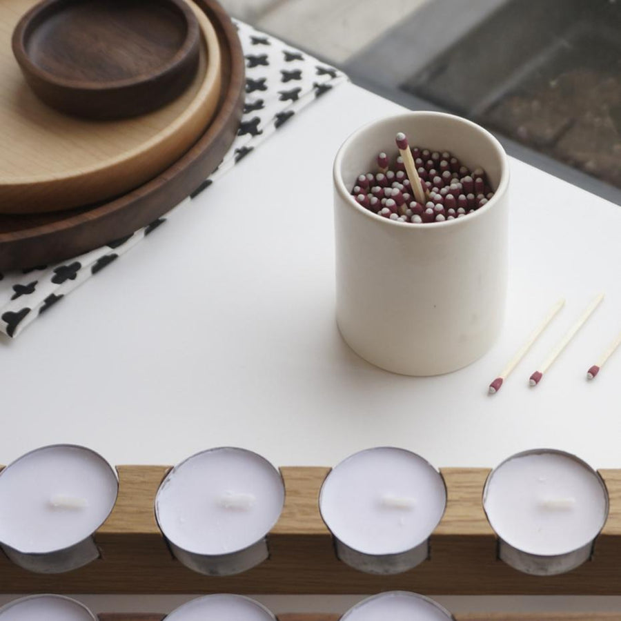 white porcelain match striker and white oak tealight holder