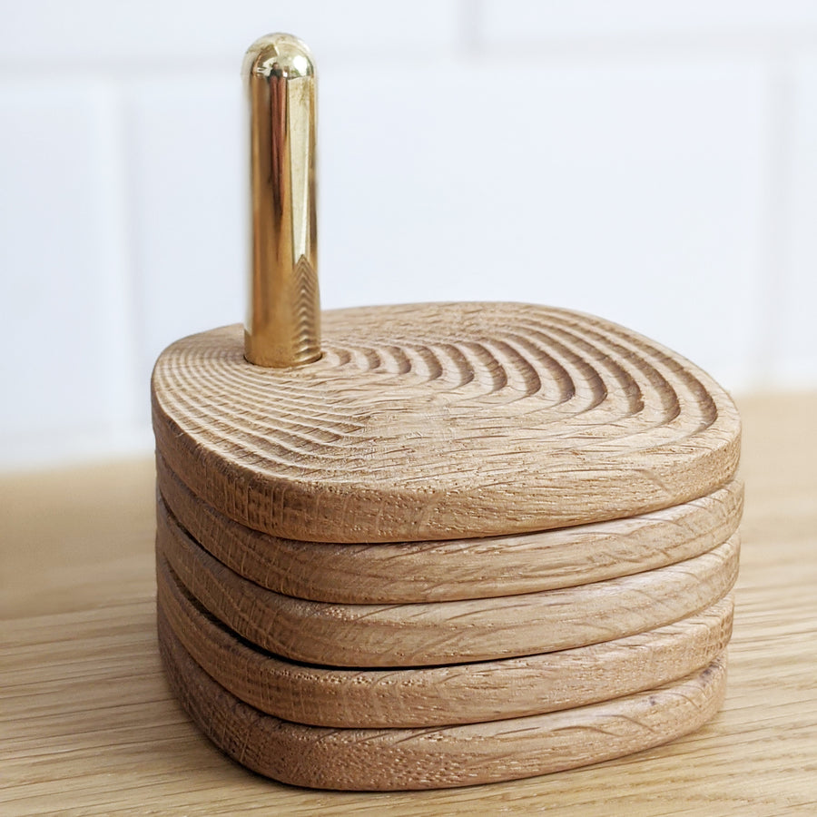 Wood and brass coaster set